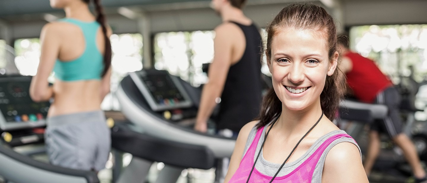 Personal Trainer with people on a treadmil