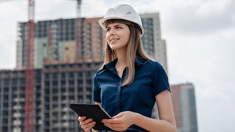 Female architecture standing in front of construction sites
