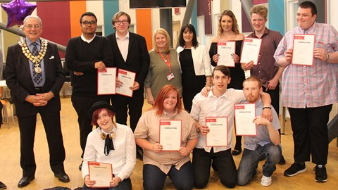 Prince's Trust award winners standing in a line showing their certificates on complete of their course with the Mayor