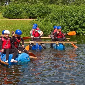 Prince's Trust students on man-made rafts in the water